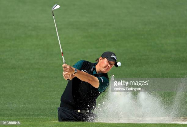 Phil Mickelson of the United States plays a shot from a bunker on the second hole during the first round of the 2018 Masters Tournament at Augusta...