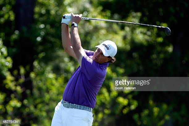 Phil Mickelson of the United States plays a shot from the fairway on the eighth hole during round two of the Shell Houston Open at the Golf Club of...