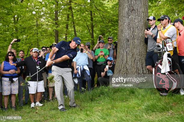 Phil Mickelson of the United States plays a shot from the rough on the third hole during the second round of the 2019 PGA Championship at the...