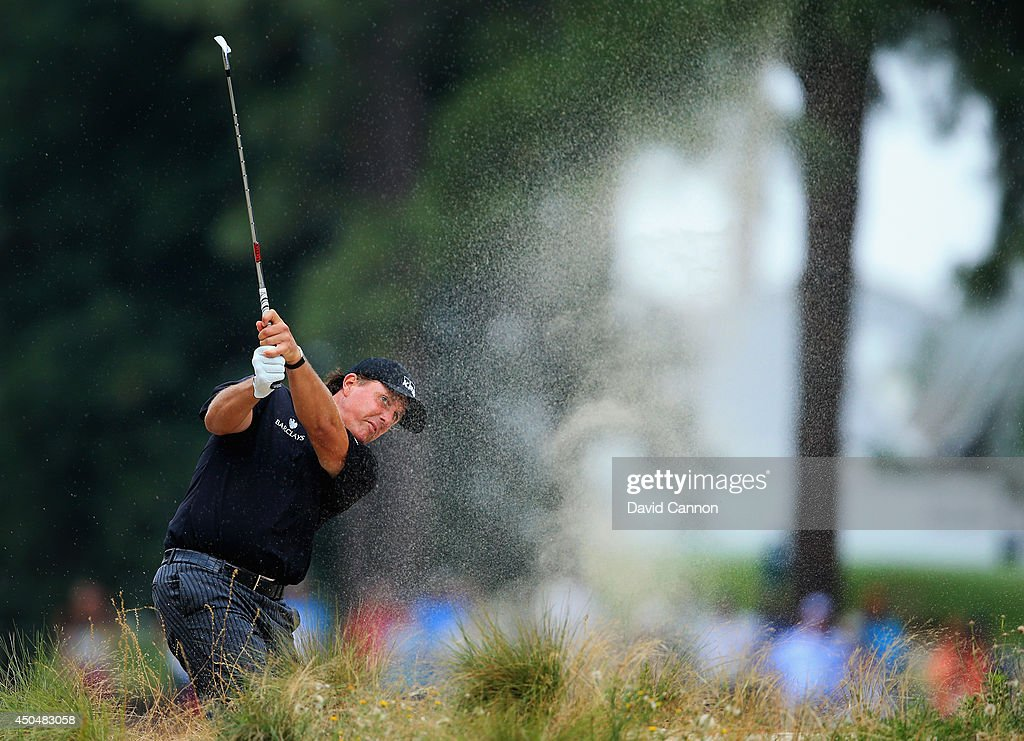Phil Mickelson of the United States plays a shot from the rough on the 12th hole during the first round of the 114th U.S. Open at Pinehurst Resort & Country Club, Course No. 2 on June 12, 2014 in Pinehurst, North Carolina.