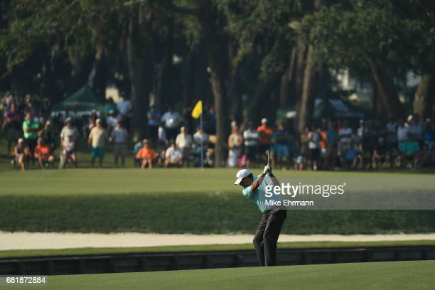Phil Mickelson of the United States plays a shot on the 11th hole during the first round of THE PLAYERS Championship at the Stadium course at TPC...