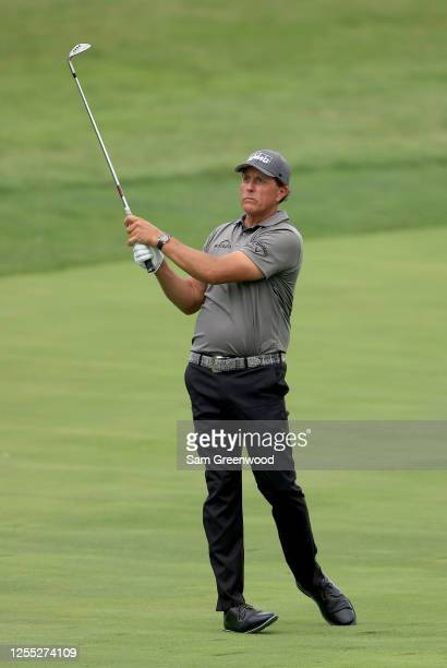 Phil Mickelson of the United States plays a shot on the 17th hole during the first round of the Workday Charity Open on July 09 2020 at Muirfield...