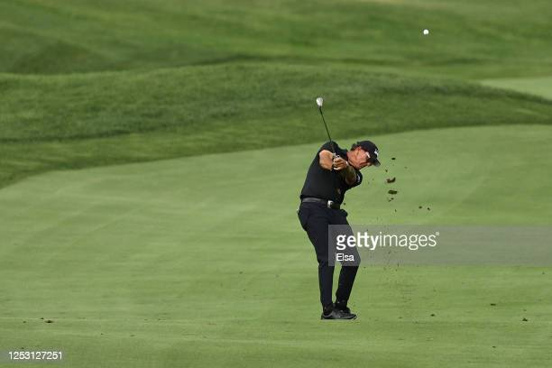 Phil Mickelson of the United States plays a shot on the 18th hole during the final round of the Travelers Championship at TPC River Highlands on June...