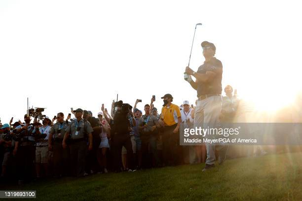 Phil Mickelson of the United States plays an approach shot on the 18th fairway during the final round of the 2021 PGA Championship held at the Ocean...