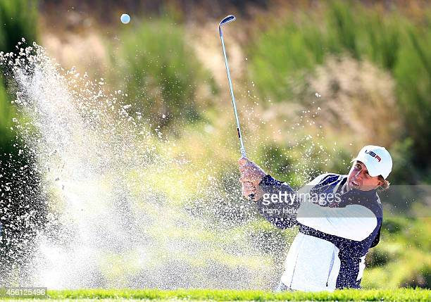 Phil Mickelson of the United States plays from a bunker on the 9th hole during the Morning Fourballs of the 2014 Ryder Cup on the PGA Centenary...