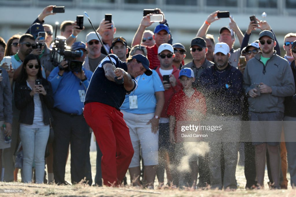 Phil Mickelson of the United States plays his second shot on the 14th hole in his match against Adam Hadwin of the International Team during the final day singles matches matches in the 2017 Presidents Cup at the Liberty National Golf Club on October 1, 2017 in Jersey City, New Jersey.