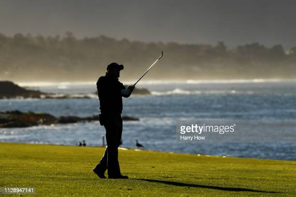 Phil Mickelson of the United States plays his second shot on the 18th hole during the continuation of the final round of the AT&T Pebble Beach Pro-Am...