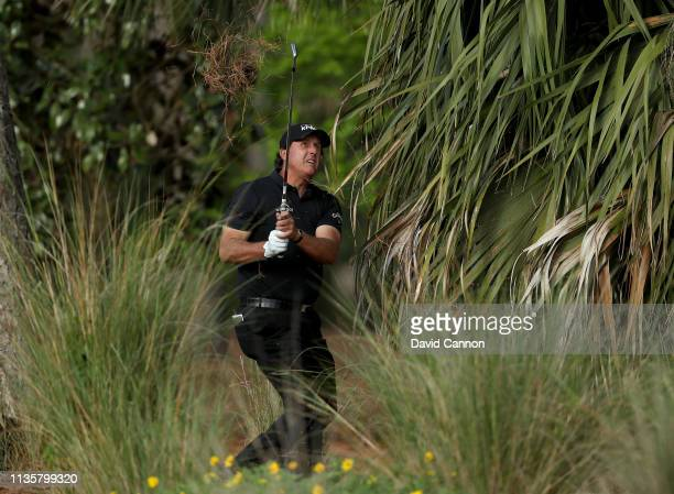 Phil Mickelson of the United States plays his second shot on the par 4 10th hole during the first round of the 2019 Players Championship held on the...