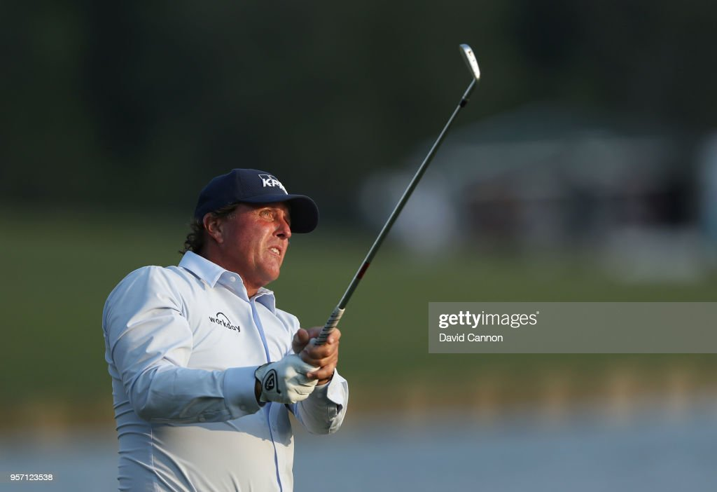 Phil Mickelson of the United States plays his second shot on the par 4, 18th hole during the first round of the THE PLAYERS Championship on the Stadium Course at TPC Sawgrass on May 10, 2018 in Ponte Vedra Beach, Florida.