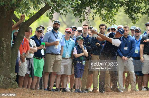 Phil Mickelson of the United States plays his second shot on the ninth hole during the second round of the 2018 Masters Tournament at Augusta...