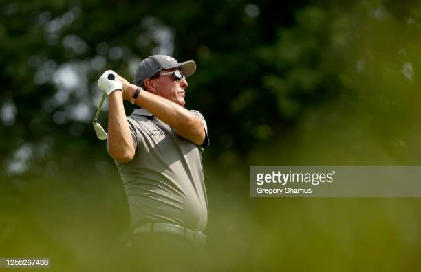 Phil Mickelson of the United States plays his shot from the 12th tee during the first round of the Workday Charity Open on July 09 2020 at Muirfield...