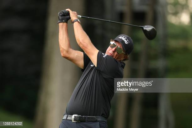 Phil Mickelson of the United States plays his shot from the 18th tee during the final round of the Travelers Championship at TPC River Highlands on...