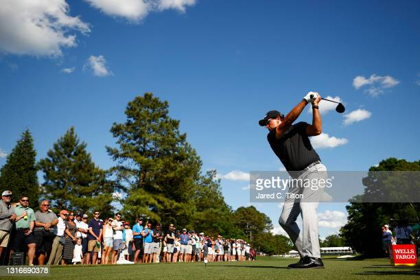 Phil Mickelson of the United States plays his shot from the eighth tee during the first round of the 2021 Wells Fargo Championship at Quail Hollow...