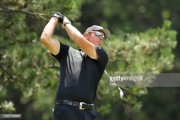 Phil Mickelson of the United States plays his shot from the fifth tee during the final round of the Travelers Championship at TPC River Highlands on...
