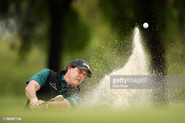 Phil Mickelson of the United States plays his third shot on the first hole in his match against Jason Day of Australia during the third round of the...