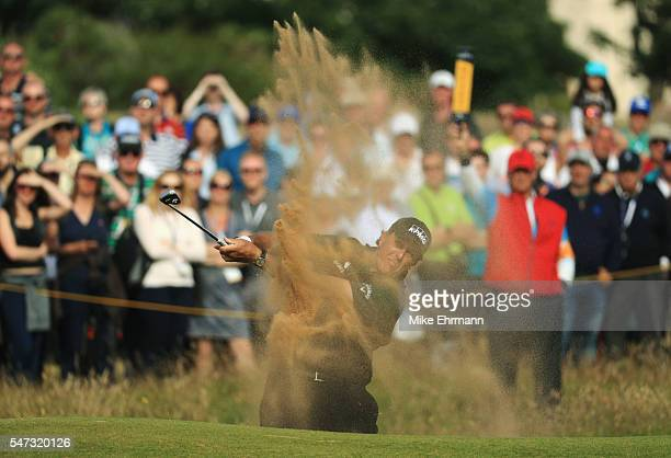 Phil Mickelson of the United States plays out of a bunker on the 16th during the first round on day one of the 145th Open Championship at Royal Troon...