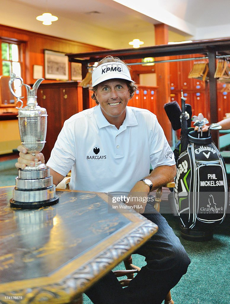 Phil Mickelson of the United States poses in the players locker room with the Claret Jug after winning the 142nd Open Championship at Muirfield on July 21, 2013 in Gullane, Scotland.