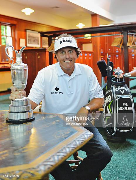 Phil Mickelson of the United States poses in the players locker room with the Claret Jug after winning the 142nd Open Championship at Muirfield on...