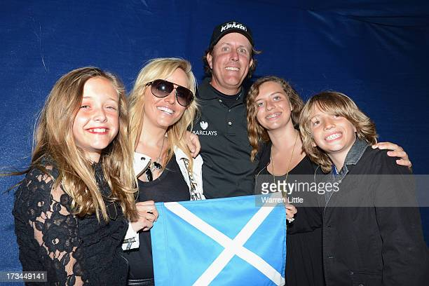 Phil Mickelson of the United States poses with his wife Amy and children Evan Amanda and Sophia after his victory on the 1st hole of a suddendeath...