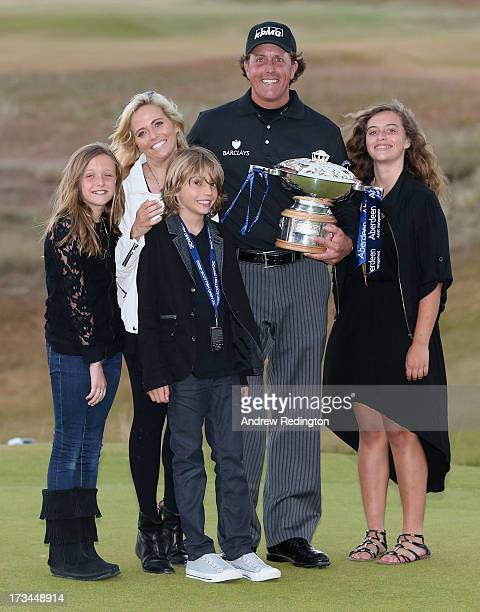 Phil Mickelson of the United States poses with the trophy and his wife Amy and children Evan Amanda and Sophia after his victory on the 1st hole of a...