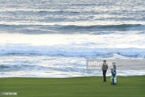 Phil Mickelson of the United States prepares to play a shot on the tenth hole during the final round of the ATT Pebble Beach ProAm at Pebble Beach...