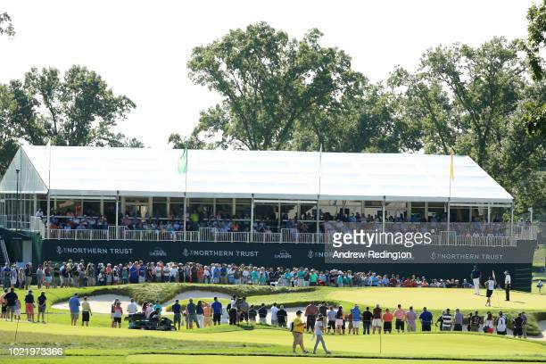 Phil Mickelson of the United States putts on the 15th green during the first round of The Northern Trust on August 23 2018 at the Ridgewood...