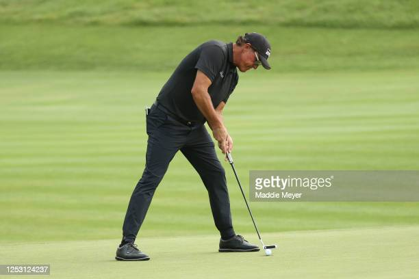 Phil Mickelson of the United States putts on the 17th green during the final round of the Travelers Championship at TPC River Highlands on June 28...