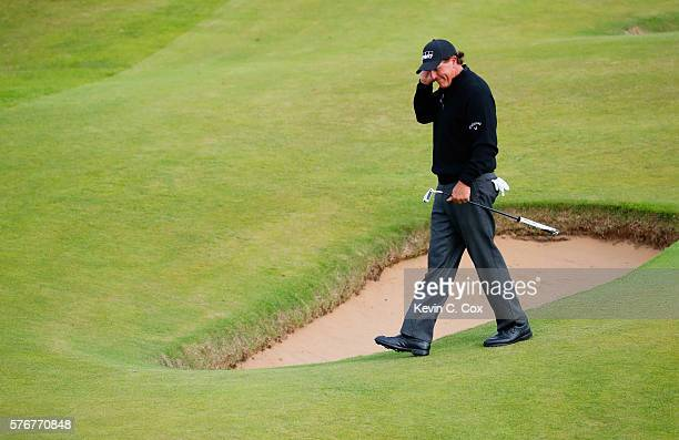 Phil Mickelson of the United States reacts after a missed eagle chance on the 16th green during the final round on day four of the 145th Open...