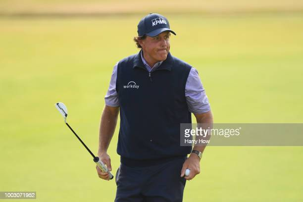 Phil Mickelson of the United States reacts after a putt on the 18th green during the third round of the 147th Open Championship at Carnoustie Golf...