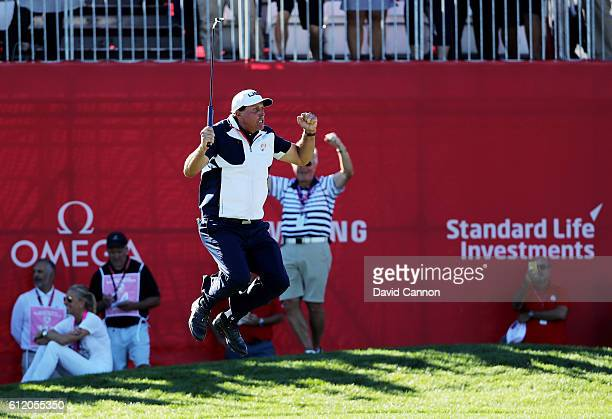 Phil Mickelson of the United States reacts after a putt on the 18th green during singles matches of the 2016 Ryder Cup at Hazeltine National Golf...