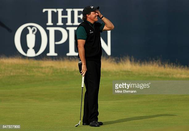 Phil Mickelson of the United States reacts after his putt narrowly missed the hole on the 18th during the first round on day one of the 145th Open...