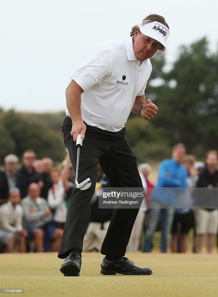 Phil Mickelson of the United States reacts after making a birdie putt on the 14th green during the final round of the 142nd Open Championship at Muirfield on July 21, 2013 in Gullane, Scotland.