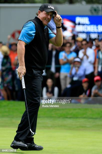 Phil Mickelson of the United States reacts after putting for birdie on the ninth hole during the third round of the World Golf Championships Mexico...