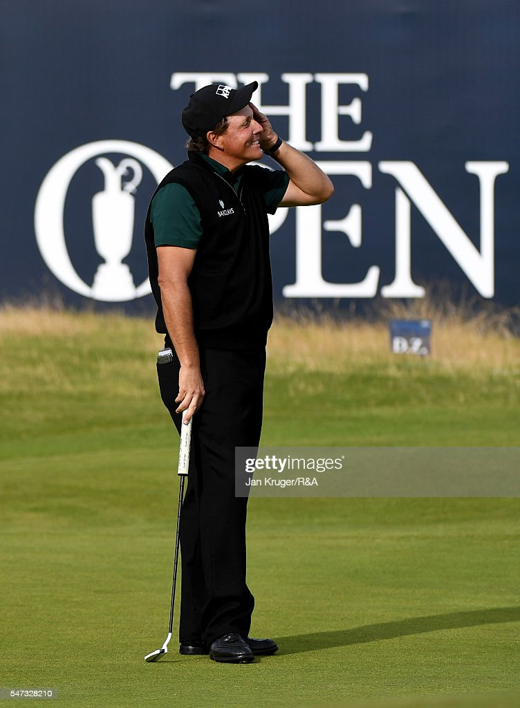 Phil Mickelson of the United States reacts on the 18th green after missing a birdie putt for a round of 62 during the first round on day one of the 145th Open Championship at Royal Troon on July 14, 2016 in Troon, Scotland.