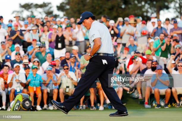 Phil Mickelson of the United States reacts on the 18th green during the first round of the Masters at Augusta National Golf Club on April 11 2019 in...