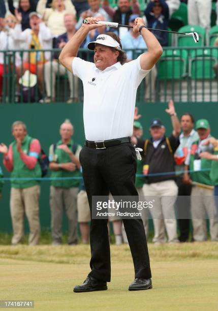 Phil Mickelson of the United States reacts to a birdie putt on the 18th green during the final round of the 142nd Open Championship at Muirfield on...