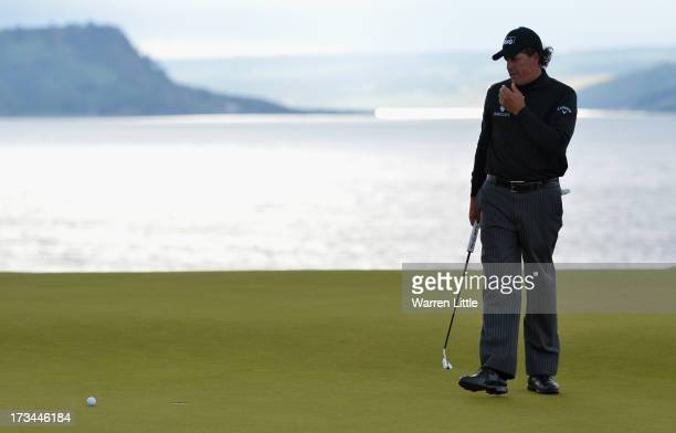 Phil Mickelson of the United States reacts to a missed putt on the 18th green to win the tournament during the final round of the Aberdeen Asset...