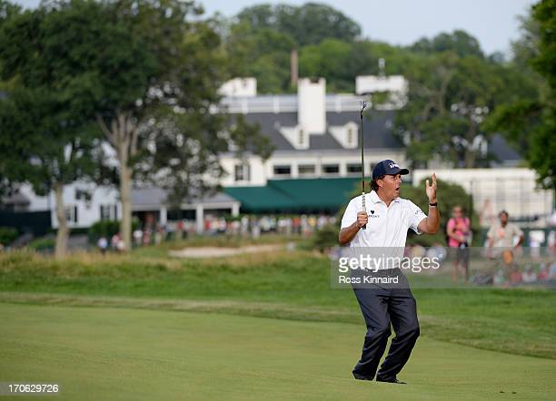 Phil Mickelson of the United States reacts to a putt on the 14th green during Round Three of the 113th U.S. Open at Merion Golf Club on June 15, 2013...