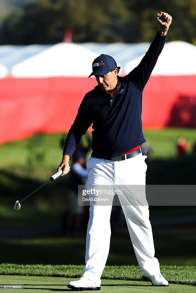 Phil Mickelson of the United States reacts to a putt on the eighth green during morning foursome matches of the 2016 Ryder Cup at Hazeltine National Golf Club on October 1, 2016 in Chaska, Minnesota.