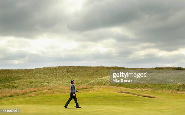 Phil Mickelson of the United States reacts to a putt on the fourth hole during the 2014 Aberdeen Asset Management Scottish Open at Royal Aberdeen on...