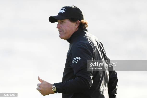 Phil Mickelson of the United States reacts to his birdie on the 11th green during the final round of the ATT Pebble Beach ProAm at Pebble Beach Golf...