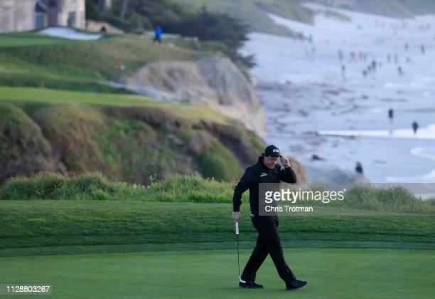 Phil Mickelson of the United States reacts to his birdie on the ninth green during the final round of the AT&T Pebble Beach Pro-Am at Pebble Beach...
