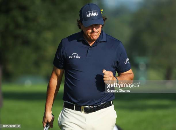 Phil Mickelson of the United States reacts to his birdie on the tenth green during the second round of The Northern Trust on August 24 2018 at the...