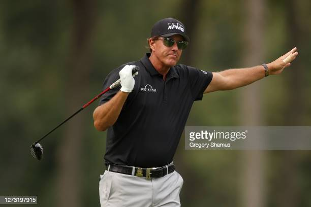 Phil Mickelson of the United States reacts to his shot from the eighth tee during the first round of the 120th US Open Championship on September 17...