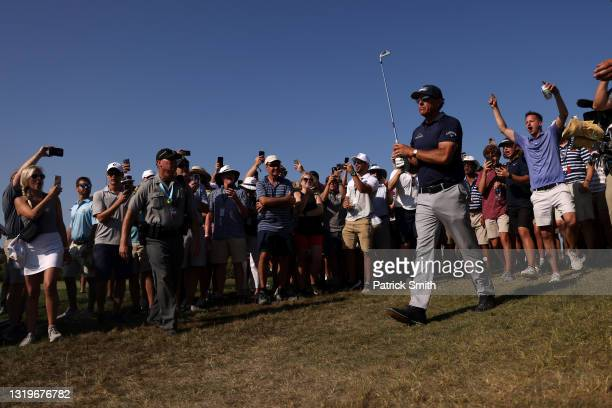 Phil Mickelson of the United States reacts to his shot on the 11th hole during the final round of the 2021 PGA Championship held at the Ocean Course...