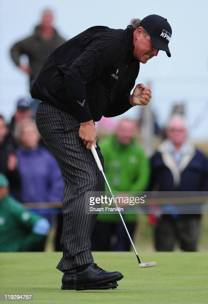 Phil Mickelson of the United States reacts to holing an eagle putt on the 5th green during the final round of The 140th Open Championship at Royal St...