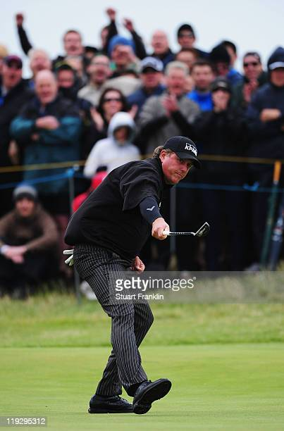 Phil Mickelson of the United States reacts to holing an eagle putt on the 7th green during the final round of The 140th Open Championship at Royal St...
