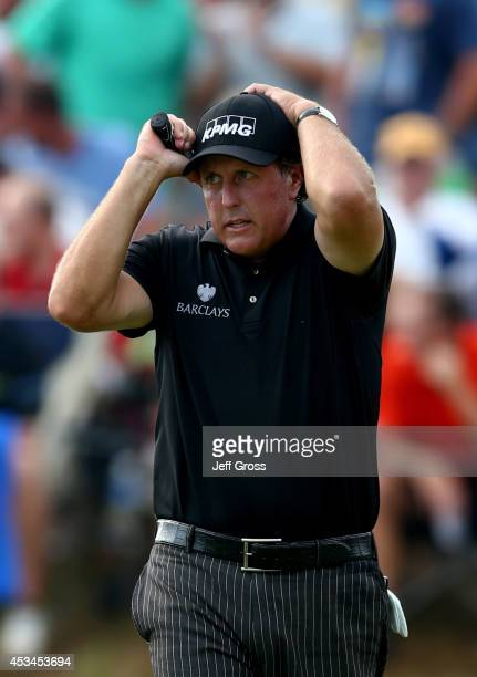 Phil Mickelson of the United States reacts to missed putt on the seventh hole during the final round of the 96th PGA Championship at Valhalla Golf...