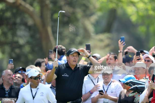 Phil Mickelson of the United States reacts to nearly holing his second shot on the second hole during the final round of the World Golf...