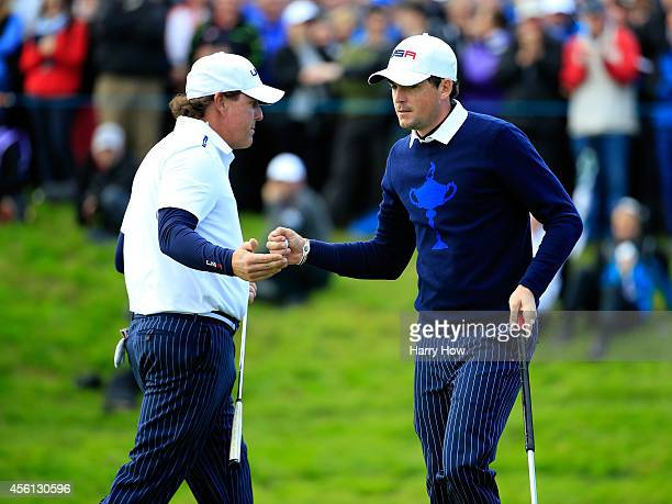 Phil Mickelson of the United States shakes hands with Keegan Bradley on the 14th green during the Morning Fourballs of the 2014 Ryder Cup on the PGA...